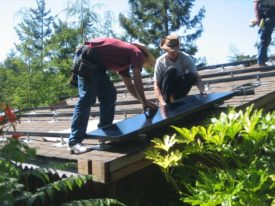 the folks at Mendocino Solar Service on the Mendocino Coast in California installing panels on a rooftop for renewable energy